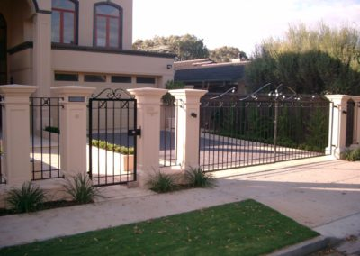 contemporary-design-automated-inwardly-opening-dual-driveway-steel-gates-with-single-entrance-gate-and-panelled-fence-the-three-gates-with-feature-scrolls-on-top