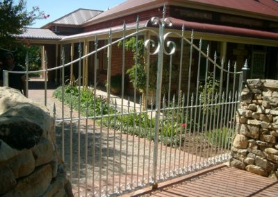 contemporary-design-dual-driveway-steel-gates-with-spears-and-a-scroll
