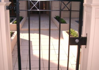 elegant-contemporary-design-single-entrance-lockable-steel-gate-with-a-scrolled-top