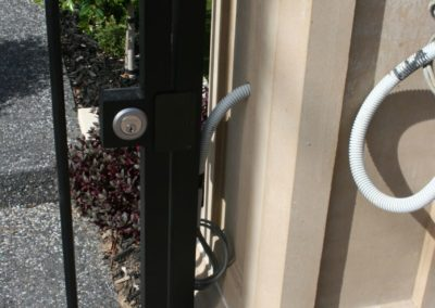 installing-the-wiring-for-custom-made-wrought-iron-fence-and-gate-with-security-and-intercom-system