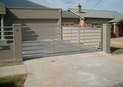 Automated electric sliding driveway gates, contemporary design featuring, galvanised iron piping panels