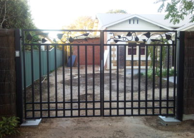 Inward opening double driveway gates, featuring modern leaf design panels