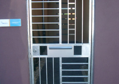 Contemporary design, single lockable front door security steel gate, with both horizontal and vertical barred panels. One of a number of different designs installed as entrance security screens in a block of self-contained units