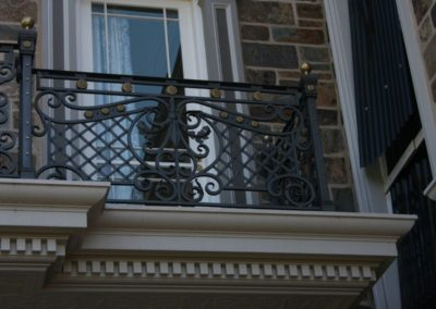 an-ornate-victorian-balustrade-highly-decorative-featuring-brass-rolls-fabricated-as-seven-different-panels-and-then-installed-on-a-t-shaped-external-balcony