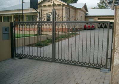 contemporary-design-double-driveway-steel-gates-self-opening-inwardly-painted-grey