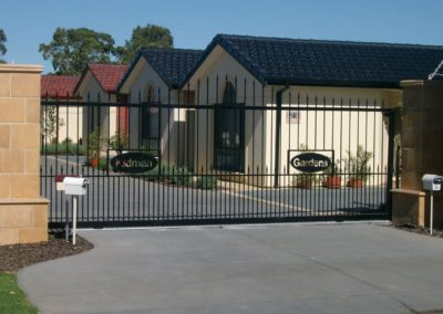 contemporary-design-driveway-steel-gates-with-spears-automated-opening-and-closing-fitted-at-the-front-of-a-retirement-village