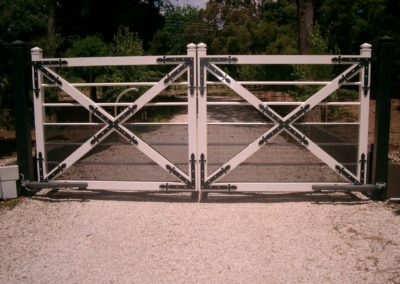 farmhouse-design-double-driveway-automated-steel-gate-featuring-black-painted-corner-and-diagonal-joining-brackets-with-vermin-proof-mesh-attached
