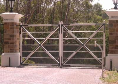 farmhouse-design-double-driveway-steel-gates-self-opening-inwardly-with-mounted-intercom-system-for-remote-control-entrance
