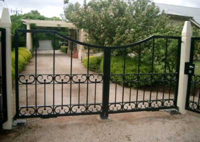 interesting-contemporary-design-double-driveway-gates-with-lockable-single-entrance-gate-set-at-an-angle-of-45-degrees