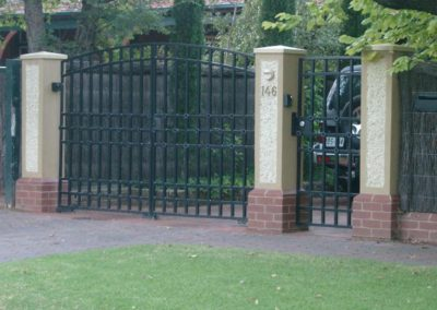 original-design-steel-double-driveway-gates-in-a-gatekeeper-style-with-a-single-entrance-gate-alongside