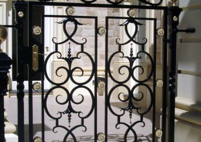 ornate-lockable-victorian-wrought-iron-gate-with-brass-rosettes-entrance-to-a-courtyard