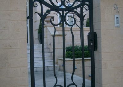 ornate-lockable-modern-design-steel-gate-entrance-to-pathway-before-staircase