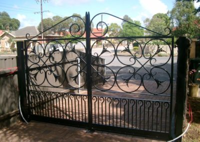 recessed-to-allow-one-car-park-dual-automated-opening-and-closing-highly-decorative-heritage-style-black-painted-steel-gates