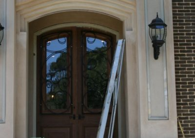 two-highly-decorative-victorian-design-security-screens-installed-on-two-wood-and-glass-doors-in-adelaide