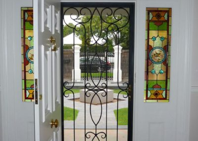 Traditional decorative style, steel, security door designed to complement leadlight surrounding windows, in house entrance